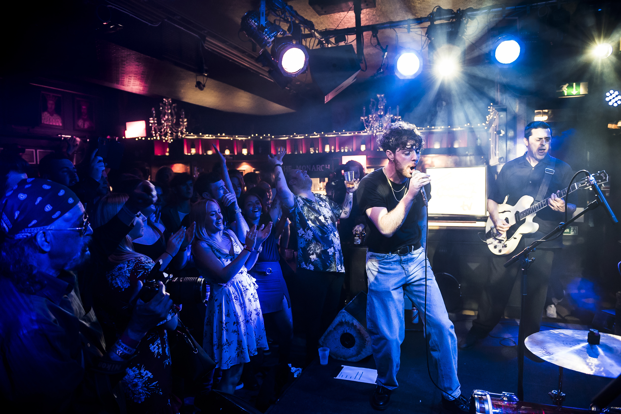 Tom Grennan performing on stage at The Monarch in front of a big crowd for Red Stripe Presents: This Feeling TV episode six.